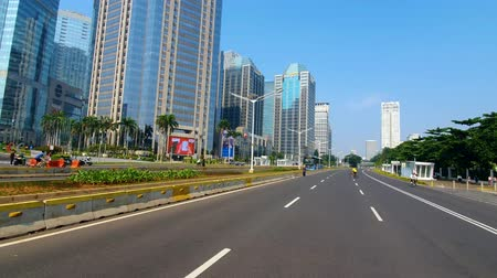 sudirman : JAKARTA, Indonesia - July 03, 2019: Empty road during car free day on the sunday morning in the Jakarta city. Shot in 4k resolution