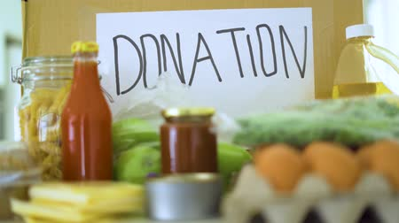 endowment : Donation concept. Foods for donation with a cardboard box. Shot in 4k resolution