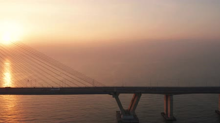 madura : Beautiful aerial landscape of Suramadu bridge on the morning at sunrise time in Surabaya, East Java, Indonesia. Shot in 4k resolution from a drone flying from right to left