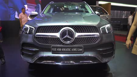 convenção : JAKARTA, Indonesia - July 23, 2019: New Mercedes-Benz GLE 450 car displayed in GAIKINDO Indonesia International Auto Show (GIIAS) 2019 at Indonesia Convention Exhibition (ICE). Shot in 4k resolution