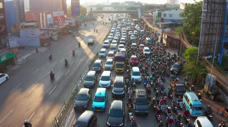 bottleneck : JAKARTA, Indonesia - July 30, 2019: Aerial view of traffic jam with crowded cars and motorcycle on the highway in Jakarta city. Shot in 4k resolution
