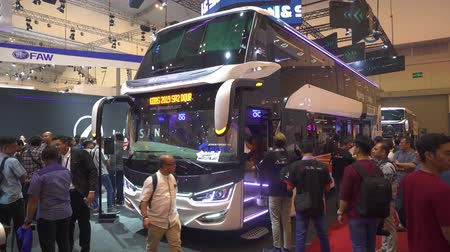 anticipo : JAKARTA, Indonesia - July 30, 2019: New Scania bus for tourism transportation displayed in GAIKINDO Indonesia International Auto Show (GIIAS) 2019. Shot in 4k resolution