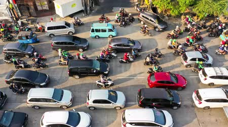indaffarato : JAKARTA, Indonesia - August 07, 2019: Aerial time lapse view of traffic jam with crowded vehicle during rush hour. Shot in 4k resolution from a drone Filmati Stock