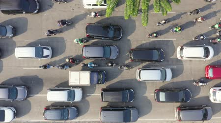 bottleneck : JAKARTA, Indonesia - August 07, 2019: Top down view of rush hour on the road with cars moving slowly during traffic jam