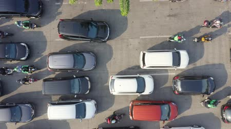bottleneck : JAKARTA, Indonesia - August 07, 2019: Top down view of traffic congestion with cars moving slowly on its lane on the morning. Shot in 4k resolution from a drone flying down