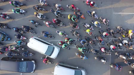 bottleneck : JAKARTA, Indonesia - August 07, 2019: Top down view of crowded motorcycle moving on traffic jam at road. Shot in 4k resolution