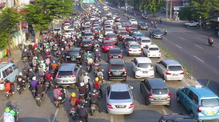 bottleneck : JAKARTA, Indonesia - August 07, 2019: Aerial landscape of rush hour with crowded vehicles moving slowly on the road. Shot in 4k resolution from a drone flying forwards Stock Footage