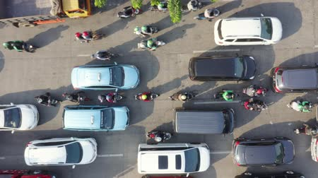 flying upwards : JAKARTA, Indonesia - August 07, 2019: Top down view of vehicle moving slowly during rush hour on the street at the morning. Shot in 4k resolution from a drone flying upwards Stock Footage