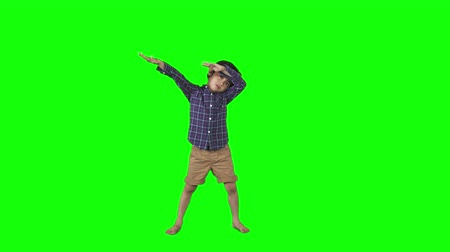 kurulamak : Little boy dancing dab or making dab gesture in the studio. Shot in 4k resolution with green screen background
