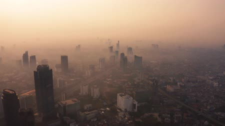 forwards : JAKARTA, Indonesia - August 27, 2019: Aerial landscape of Jakarta skyline with dangerous air pollution above the city. Shot in 4k resolution from a drone flying forwards