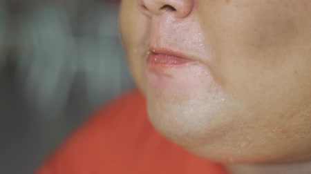 欲 : Closeup of overweight man mouth eating crunchy fried chicken in the restaurant. Shot in 4k resolution