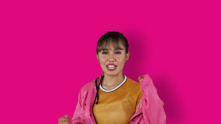 hiphop : Slow motion of cheerful hip-hop dancer expressing her success in the studio with pink background
