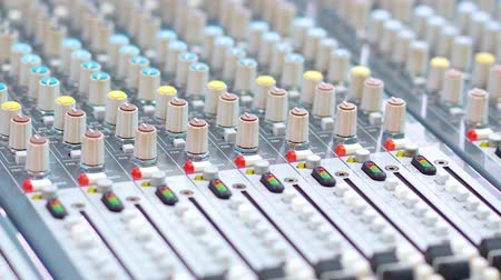 Closeup of sound and audio mixer control panel with buttons and sliders. Shot in 4k resolution