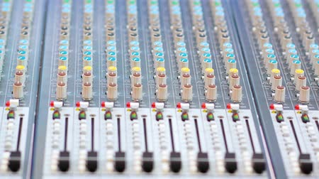 ekolayzer : Closeup of audio sound mixer console with buttons and sliders. Shot in 4k resolution Stok Video