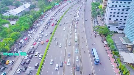 bottleneck : JAKARTA, Indonesia - January 27, 2020: Aerial view of tollway during rush hour with cars queuing on traffic jam.