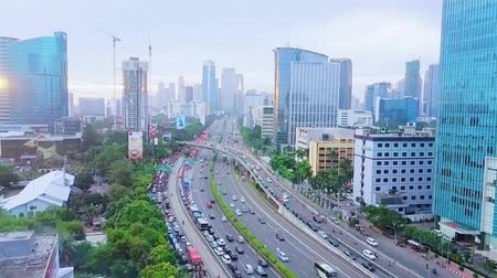 toll : JAKARTA, Indonesia - January 27, 2020: Aerial time lapse of vehicle moving on traffic jam with cityscape background Stock Footage