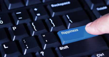 presleme : Close up of human hand pressing an Happiness button with blue color on the computer keyboard. Shot in 4k resolution