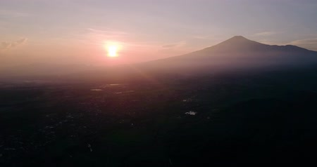 Aerial footage of sunrise with mountain background and suburban houses on misty morning. Shot in 4k resolution Wideo