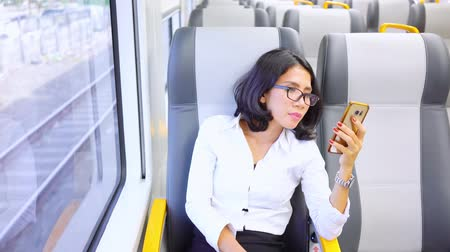 Beautiful businesswoman using a mobile phone in the airport train. Shot in 4k resolution