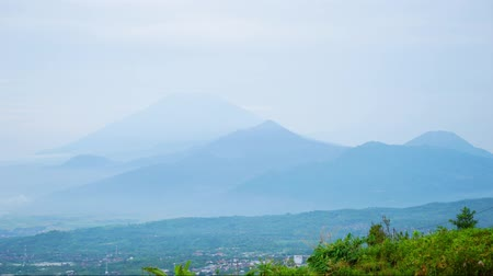 Time lapse footage of mountain view on misty morning at Subang highland, West Java, Indonesia