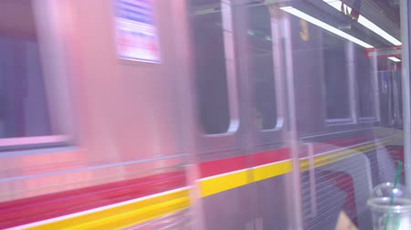 Video footage of a commuter train leaves station and moving on railway. Shot in 4k resolution
