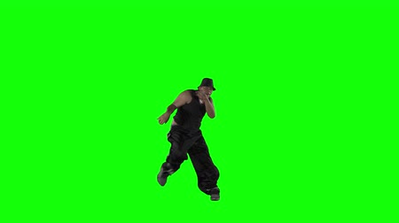 Young man break dancing in the studio. Shot in 4k resolution with green screen background