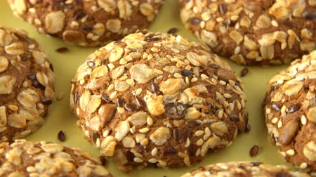len : Delicious yummy freshly baked homemade oatmeal cookies rotating on a green bamboo plate. Looped. Stock mozgókép