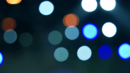 sel : Bright flashing white, yellow and blue lights at musical concert. Set colorful of lights turning on and off. Holiday garland or bokeh Stok Video