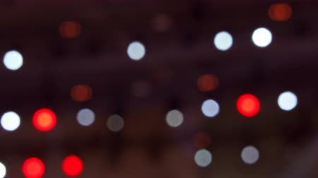 sel : Bright flashing red, yellow and blue lights at musical concert. Set colorful of lights turning on and off. Holiday garland or bokeh