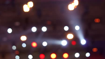 sel : Bright flashing red, yellow and white lights at musical concert. Set colorful of lights turning on and off. Holiday garland or bokeh