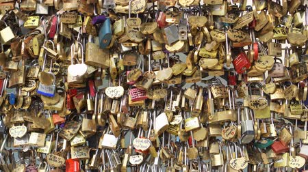 luxe : PARIS, FRANCE- CIRCA August 2017: Bridge fence full of locks. Lovers Romantic Bridge in Paris.