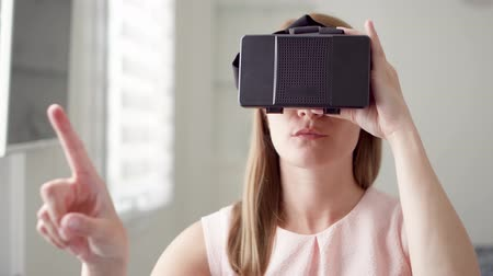 double happiness : Young pretty woman using VR virtual reality 360 glasses at home. Making browse, zoom and tap gestures Stock Footage