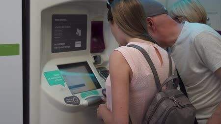 vending machine : PARIS, FRANCE- CIRCA August 2017: Family using self-service machine to buy subway tickets in Paris metro. Paying by debit card