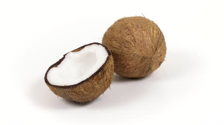 rehydration : One ripe whole brown tropical coconut and a half with yummy white pulp rotating on white isolated background. Healthy fresh tropical fruits. Loopable seamless cocos rotating