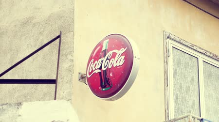 coque : CYPRUS, LARNACA - CIRCA April 2018: Street advertising of worldwide famous soda brand. Popular american soft drink Coca-Cola logo Stock Footage