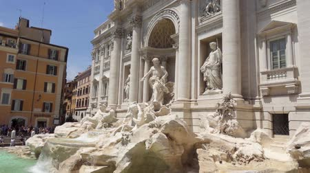 olasz kultúra : ROME, ITALY - CIRCA May 2018: Exterior of Trevi Fountain in center of Rome city, Italy. Beautiful historical european architecture Fontana di Trevi. Water flowing in slow motion. Camera moving up