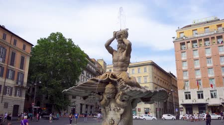 triton : ROME, ITALY - CIRCA May 2018: Famous Triton Fountain in Barberini square in Rome, Italy. Beautiful european architecture outdoors. People walking around