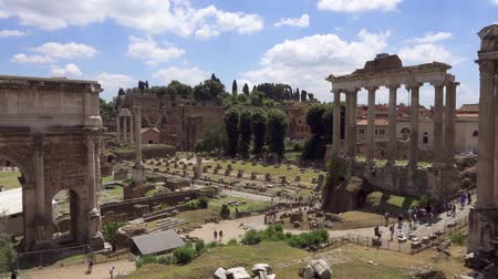 Exterior of ancient ruins Forum Romanum. Unrecognizable people walking through Roman forum in center of Rome, Italy. Historical european architecture. Columns and stones of old monument in slow motion Stok Video
