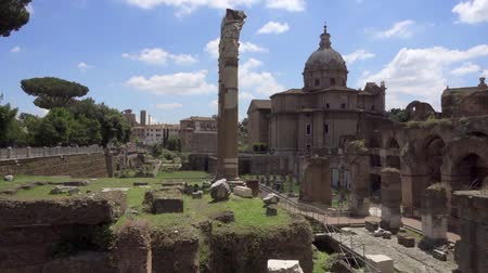 Panorama of ancient ruins Forum Romanum. Roman forum in center of Rome city, Italy. Beautiful historical european architecture. Columns and stones of old monument in slow motion