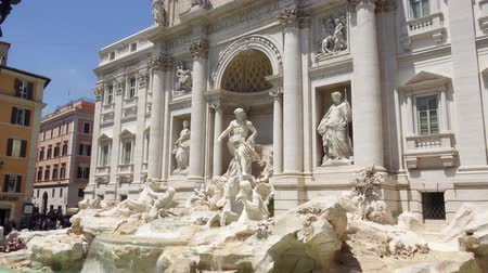 ROME, ITALY - CIRCA May 2018: Exterior of Trevi Fountain in center of Rome city, Italy. Beautiful historical european architecture Fontana di Trevi. Camera moving up Wideo