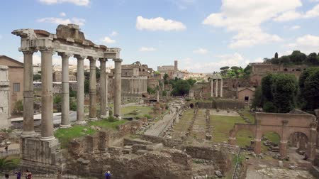 Exterior of ancient ruins Forum Romanum. Unrecognizable people walking through Roman forum in center of Rome, Italy. Historical european architecture. Columns and stones of old monument in slow motion Wideo