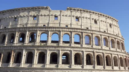 Famous Italian attraction Colosseum in Rome. Veiw on ancient Flavius amphitheater Coliseum in capital of Italy. Camera moving from right to left