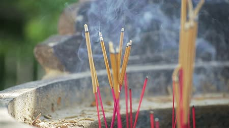 myrrh : Burning incense sticks in a pagoda