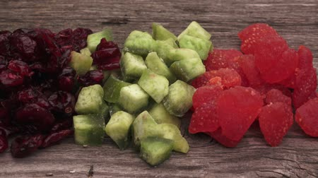 cukrozott : Colorful candied fruits assortment. Candied fruits on wooden background.