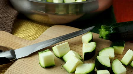 джут : Healthy chopped zucchini on a cutting board with knife Стоковые видеозаписи