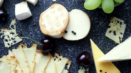 cheese types : Cold appetizer. Cold cuts. Cheese on cutting board, top view