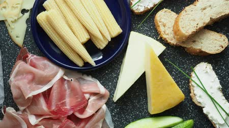 bread stick : Cold appetizer. Cold cuts. Spicy food on black background, top view. Stock Footage