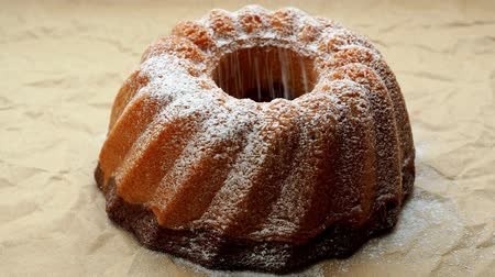 kasza manna : Home made freshly baked whole marble cake covered with powdered sugar on paper. Wideo