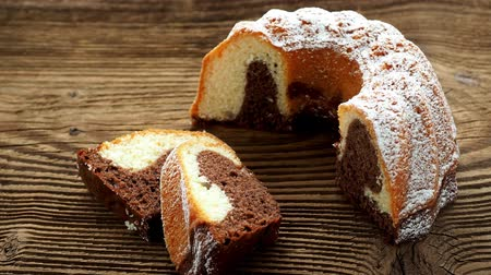 kasza manna : Traditional homemade marble cake. Sliced marble bundt cake on wooden table