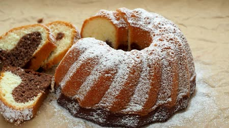 búzadara : Traditional homemade marble cake. Sliced marble bundt cake on paper.